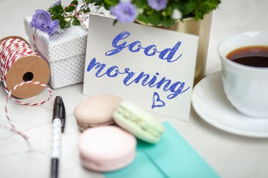 filled-teacup-with-saucer-beside-good-morning-card-and-pen-2072152